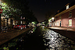 A view of a canal at night in Delft, Holland