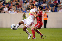 Thierry Henry (14) of the New York Red Bulls plays the ball under pressure from Dan Gargan (3) of the Chicago Fire. The New York Red Bulls and the Chicago Fire played to a 2-2 tie during a Major League Soccer (MLS) match at Red Bull Arena in Harrison, NJ, on August 13, 2011.