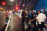 Police arrest a youth on opening night for the Barclays Center in Brooklyn in New York on Friday, September 28, 2012. The new venue opened with eight concerts by the rapper Jay-Z, a part owner in the arena, and is expected to be the major economic engine for a change in the neighborhood.   (© Richard B. Levine)