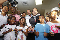 Mayor of Jerusalem, Nir Barkat (Center R), founder and current president of the International Fellowship of Christians and Jews, Rabbi Yechiel Eckstein (Center L) and children of Ethiopian Jewish immigrants cut the ribbon during an inauguration ceremony for a new Ethiopian Spiritual Center in Jerusalem, on June 23, 2013. The new center was funded by The International Fellowship of Christians and Jews.  Photo by Oren Nahshon