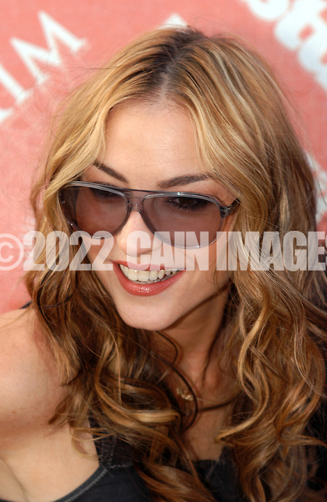 """ATLANTIC CITY, NJ - JUNE 26: Actress Drea De Matteo arrives at the Maxim Magazine Presents """"Fantasy Island"""" at the Borgata Hotel Casino and Spa June 26, 2004 in Atlantic City, New Jersey. The event consisted of two music stages and four unique themed areas, providing a wide array of entertainment for guests; South Beach Venice Beach, Stuffland, and The Oasis. (Photo by William Thomas Cain/Getty Images)"""