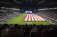 SAN JOSE, CA - March 24, 2017: The national flag is unfurled before the CONCACAF World Cup Qualifier game between the USA and Honduras at Avaya Stadium.
