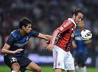 FUSSBALL INTERNATIONAL   SERIE A   SAISON  2012/2013   7. Spieltag AC Mailand  - Inter Mailand                     07.10.2011 Giampaolo Pazzini (re, AC Mailand) gegen Andrea Ranocchia (Inter Mailand)