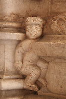 Sculptural detail of a child trapped between stone slabs, in the arcade of the Cloister, built in Manueline style by Diogo Boitac, Joao de Castilho and Diogo de Torralva, completed 1541, in the Jeronimos Monastery or Hieronymites Monastery, a monastery of the Order of St Jerome, built in the 16th century in Late Gothic Manueline style, Belem, Lisbon, Portugal. The cloister wings have wide arcades with rectangular column and tracery within the arches. The monastery is listed as a UNESCO World Heritage Site. Picture by Manuel Cohen