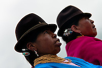 "Women, wearing men's hats, watch a procession during the Inti Raymi celebration in Pichincha province, Ecuador, 26 June 2010. Inti Raymi, ""Festival of the Sun"" in Quechua language, is an ancient spiritual ceremony held in the Indian regions of the Andes, mainly in Ecuador and Peru. The lively celebration, set by the winter solstice, goes on for various days. The highland Indians, wearing beautiful costumes, dance, drink and sing with no rest. Colorful processions in honor of the God Inti (Sun) pass through the mountain villages giving thanks for the harvest and expressing their deep relation to the Mother Earth (Pachamama)."