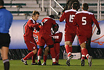 13 November 2009: NC State's Ronnie Bouemboue (7) is mobbed by teammates after scoring a goal. The North Carolina State University Wolfpack defeated the Boston College Eagles 1-0 at WakeMed Stadium in Cary, North Carolina in an Atlantic Coast Conference Men's Soccer Tournament Semifinal game.