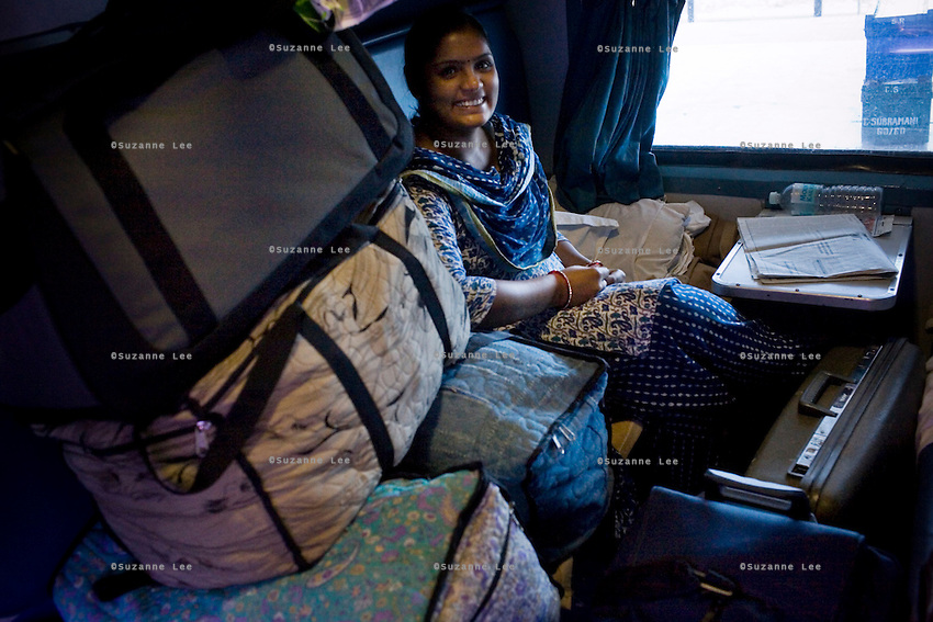 Seema Surana and her husband, Naresh Surana (unseen) gets her luggage ready for their stop. Travelling with 10 suitcases, this is their final trip of gradually moving personal belongings from Bikaner, Rajasthan to Tirupur, Tamil Nadu on 9th July 2009.. .6318 / Himsagar Express, India's longest single train journey, spanning 3720 kms, going from the mountains (Hima) to the seas (Sagar), from Jammu and Kashmir state of the Indian Himalayas to Kanyakumari, which is the southern most tip of India...Photo by Suzanne Lee / for The National