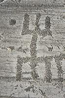 "Petroglyph, rock carving, of schematic human figures in the so called ""Prayer"" position. Carved by the ancient Camuni people in the Late Copper Age between 3200- 2200 BC. Rock no 24,  Foppi di Nadro, Riserva Naturale Incisioni Rupestri di Ceto, Cimbergo e Paspardo, Capo di Ponti, Valcamonica (Val Camonica), Lombardy plain, Italy"