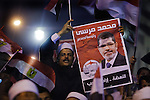 Supporters of Egyptian Islamist presidential candidate Dr. Mohamed Morsy cheer the candidate at a May 17, 2012 campaign rally in the Nile delta city of Benha, Egypt. Morsy, the Muslim Brotherhood's candidate once lagged far behind in the polls, but is now considered a strong underdog candidate because of the legendary organizational machine his group commands during election times. (Photo by Scott Nelson)