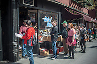 Shoppers line up outside Rebel Rebel records on Bleecker Street in the Greenwich Village neighborhood of New York is seen on Saturday, April 20, 2013. on Record Store Day.  Music lovers are encouraged to support their local non-chain record stores.  (© Richard B. Levine)