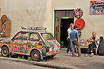A colorful car, a musician, a cafe, and a store in Krakow, Poland
