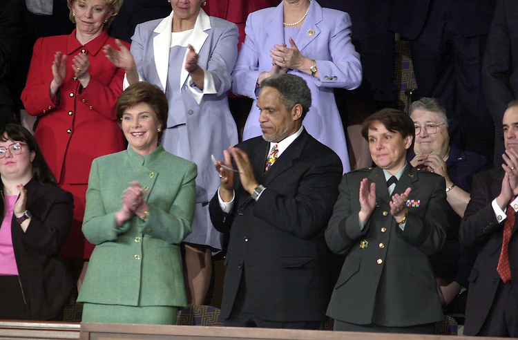 6joint022701 -- Laura Bush give her approval during her husbands address to the Joint Session of Congress.