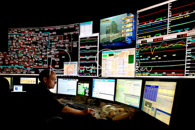 System coordinators inside of Duke Energy's System Operating Center manage the electric load of power delivery for Duke Energy Carolinas portion of the power grid. The coordinators are working inside Duke Energy's Charlotte, North Carolina facilty.
