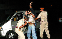 A local man is searched by police after multiple terrorist attacks were launched in Mumbai on 26/11/2008. He was found to be innocent.