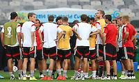 Germany coach Joachim Loew talks to his players during training ahead of tomorrow's semi final vs Brazil