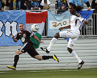 Branden Barklage(24) of D.C. United crosses the ball in front of Keon Daniel(17) of the Philadelphia Union during a play-in game for the US Open Cup tournament at Maryland Sportsplex, in Boyds, Maryland on April 6 2011. D.C. United won 3-2 after overtime penalty kicks.