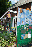 Whimsical painted and decorated flea market finds garden shed