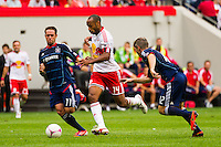 Thierry Henry (14) of the New York Red Bulls  is defended by Daniel Paladini (11) and Logan Pause (12) of the Chicago Fire during a Major League Soccer (MLS) match at Red Bull Arena in Harrison, NJ, on October 06, 2012.
