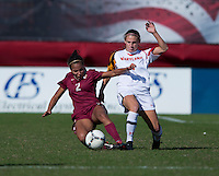 Cory Ryan (4) of Maryland has the ball tackled away from her by Ines Jaurena (2) of Florida State during the game at Ludwing Field in College Park, MD.  Florida State defeated Maryland, 1-0.