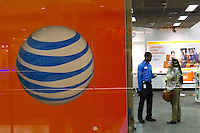 New York, United States. 19th May 2014 - A workers and a customer are seen on a AT&T store in Jersey City, New Jersey. Photo by Eduardo MunozAlvarez/VIEW