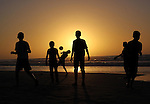 Palestinian children play Football during sunset at the beach of Gaza's sea on January 31, 2015. Photo by Mohammed Asad