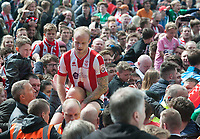 Lincoln City's Bradley Wood is carried on fans shoulders at full time<br /> <br /> Photographer Andrew Vaughan/CameraSport<br /> <br /> Vanarama National League - Lincoln City v Macclesfield Town - Saturday 22nd April 2017 - Sincil Bank - Lincoln<br /> <br /> World Copyright &copy; 2017 CameraSport. All rights reserved. 43 Linden Ave. Countesthorpe. Leicester. England. LE8 5PG - Tel: +44 (0) 116 277 4147 - admin@camerasport.com - www.camerasport.com