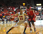 "Ole Miss' Marshall Henderson (22) vs. Rutgers' Eli Carter (5) at the C.M. ""Tad"" Smith Coliseum in Oxford, Miss. on Saturday, December 1, 2012. Mississippi won 80-67. (AP Photo/Oxford Eagle, Bruce Newman).."