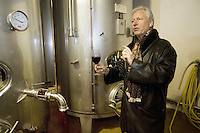 "Switzerland. Canton Ticino. Ligornetto. Luigi Zanini. Wine grower and producer. Owner of the firm ""Vinattieri Ticinesi"" . Luigi Zanini is tasting a 2007 Merlot red wine. Wineglass. Fermenting cellar for last harvested grapes. Inox tuns.  © 2008 Didier Ruef"
