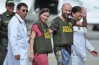 BOGOT&Aacute; -COLOMBIA. 15-06-2013.  &Aacute;ngel S&aacute;nchez Fern&aacute;ndez y  Mar&iacute;a Marlaska Sedano a su llegada a la ciudad de Bogot&aacute;, Colombia despu&eacute;s de haber sido rescatados por el Gaula de la Polic&iacute;a Nacional en el departamento de La Guajira, Colombia./ Angel Sanchez Fernandez and MariS Marlaska Sedano during thieir arrival to Bogot&aacute;, Colombia after being recaed by Gaula of National Police of Colombia in Rioacha department. Photo: VizzorImage/Mauricio Orjuela/MDC/ CONT<br /> MANDATORY EDITORIAL USE ONLY - NO ADVERTISING - NO SALES - MANDTORY CREDIT MAURICIO ORJUELA MDC