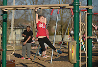 NWA Democrat-Gazette/BEN GOFF @NWABENGOFF<br /> Madelyn Keeter, 7, makes her way across the monkey bars Saturday, Feb. 11, 2017, while playing at Centerton City Park with her family.