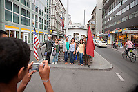 Checkpoint Charlie was the most famous crossing point between East and West Berlin during the Cold War, where the Soviet and American Sectors faced off across the Berlin Wall. Today it is a tourist attraction with German students posing as Soviet and American soldiers..