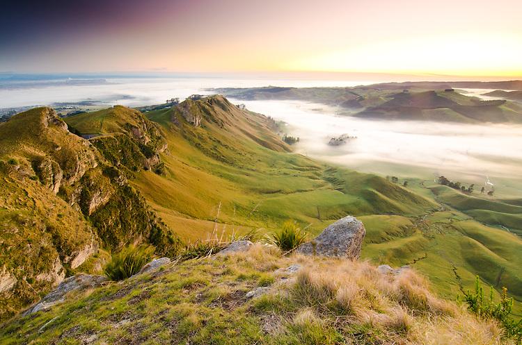 Te Mata Peak at sunrise. Mist filled valley, Hawkes Bay, North Island, New Zealand