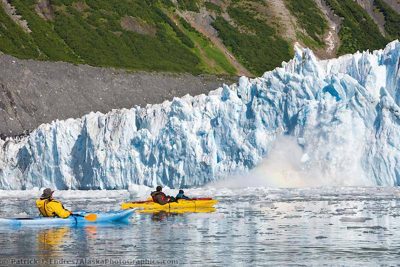 Tourists from the MV Discovery, enjoy a sea kayak excursion in the ice berg filled waters of Barry Arm at Barry Glacier, Chugach mountains, Chugach National forest, Prince William Sound, southcentral, Alaska.