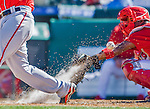 6 March 2016: St. Louis Cardinals catcher Alberto Rosario is sprayed by dirt as a foul ball bounces back during a Spring Training pre-season game against the Washington Nationals at Roger Dean Stadium in Jupiter, Florida. The Nationals defeated the Cardinals 5-2 in Grapefruit League play. Mandatory Credit: Ed Wolfstein Photo *** RAW (NEF) Image File Available ***