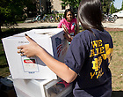Aug. 23, 2013; Welsh Family Hall staff help a first-year resident on move-in day.<br /> <br /> Photo by Matt Cashore/University of Notre Dame