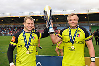 Matthew Tait and Luke Hamilton of Leicester Tigers pose with the Anglo-Welsh Cup trophy. Anglo-Welsh Cup Final, between Exeter Chiefs and Leicester Tigers on March 19, 2017 at the Twickenham Stoop in London, England. Photo by: Patrick Khachfe / JMP