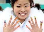 A kimono-clad 20-year-old Japanese women shows off her accessories after a ceremony held for Coming-of-Age Day at Toshimaen amusement park in Tokyo, Japan. While Japanese women can marry as early as 16 years of age and men at 18, neither is considered to reach adulthood until they reach 20, when they can also legally begin to smoke, drink and vote.COMING OF AGE