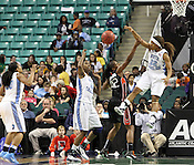 UNC guard Cetera DeGraffenreid blocks a Miami shot in the second half. This game was one of the two Semifinal games of the 2011 ACC Tournament in Greensboro on Saturday, March 5, 2011. UNC beat Miami 83-57. (Photo by Al Drago)