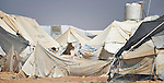 A child amid weathered tents in the Zaatari refugee camp near Mafraq, Jordan. Established in 2012 as Syrian refugees poured across the border, the camp held more than 80,000 refugees by early 2015, and was rapidly evolving into a permanent settlement. The ACT Alliance provides a variety of services to refugees living in the camp.