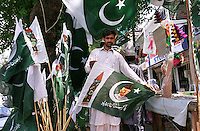 © Piers Benatar/Panos Pictures..Islamabad, Pakistan. 2001...Nationalistic merchandise on sale on a street stall.
