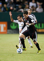 CARSON, CA – SEPTEMBER 18:  LA Galaxy defender Sean Franklin (28) and DC United midfielder Santino Quaranta (25) during a soccer match at Home Depot Center, September 18, 2010 in Carson California. Final score LA Galaxy 2, DC United 1.