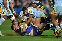 David Wilson is tackled to ground. Aviva Premiership match, between Bath Rugby and Northampton Saints on September 14, 2012 at the Recreation Ground in Bath, England. Photo by: Patrick Khachfe / Onside Images