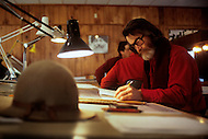 Wasco, Oregon, February 1984: A disciple of Bhagwan Rajneesh working on an architectural plan in a office in Rajneeshpuram.   Rajneeshpuram, was an intentional community in Wasco County, Oregon, briefly incorporated as a city in the 1980s, which was populated with followers of the spiritual teacher Osho, then known as Bhagwan Shree Rajneesh. The community was developed by turning a ranch from an empty rural property into a city complete with typical urban infrastructure, with population of about 7000 followers.