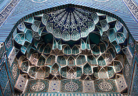 Detail of decorative tiling, Mausoleum, 1361, Shah-I Zinda Complex,  Samarkand, Uzbekistan, pictured on July 19, 2010, in the morning. The Shah-i-Zinda Complex is a necropolis of mausoleums whose legendary origin dates back to 676 when Kussam-ibn-Abbas arrived to convert the locals to Islam. So successful was he that he was assassinated whilst at prayer. His grave remains the centre of the sacred site which grew over many centuries, especially the 14th and 15th, into an architecturally stunning  example of ceramic art. This mausoleum is trimmed with carved slip terracota. One of Timur's wives might have been buried here. Samarkand, a city on the Silk Road, founded as Afrosiab in the 7th century BC, is a meeting point for the world's cultures. Its most important development was in the Timurid period, 14th to 15th centuries. Picture by Manuel Cohen.