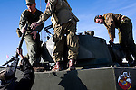"World War II re enactors Ted Hutton and Tom Morgan shoot a machine gun atop a tank at the Rocky Mountain Fifty Caliber Shooting Association's 2009 Machine Gun Shoot.  ..Each year the organization holds two sanctioned machine gun shoots during which machine gun owners and vendors bring their guns to shoot for a three day-long event.  Organizer Bob McBride described the muddy Fort Morgan event as ""machine gun Woodstock without the dope.""  The annual events draw shooters from around the world to shoot at propane tanks, cars filled with fuel, boxes of stick dynamite, and other ""reactive "" targets.  People wishing to own automatic firearms must be licensed by the federal government to purchase the weapon."