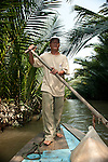 Mekong River small boat operator