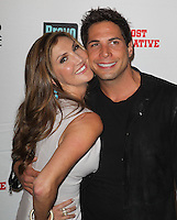 Heather McDonald, Joe Francis.Bravo's Andy Cohen's Book Release Party For &quot;Most Talkative: Stories From The Front Lines Of Pop Held at SUR Lounge, West Hollywood, California, USA..May 14th, 2012.half length grey gray black jacket dress side arm around waist hug embrace .CAP/ADM/KB.&copy;Kevan Brooks/AdMedia/Capital Pictures.