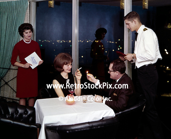 Man lighting woman's cigarette in the restaurant.