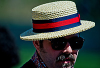 LEXINGTON, KENTUCKY - APRIL 08: A fan sports a straw hat on Blue Grass Stakes Day at Keeneland Race Course on April 8, 2017 in Lexington, Kentucky. (Photo by Scott Serio/Eclipse Sportswire/Getty Images)