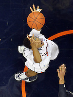 CHARLOTTESVILLE, VA- NOVEMBER 29: Malcolm Brogdon #22 of the Virginia Cavaliers grabs a rebound during the game on November 29, 2011 at the John Paul Jones Arena in Charlottesville, Virginia. Virginia defeated Michigan 70-58. (Photo by Andrew Shurtleff/Getty Images) *** Local Caption *** Malcolm Brogdon